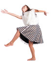 Girl in dress dances barefoot a and plays the fool Royalty Free Stock Photos
