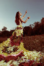 Girl in the dress of the firebird of flowers topless a made Royalty Free Stock Image