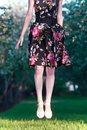 Girl in a dress jumps on a green lawn Royalty Free Stock Photos