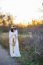 Girl in dress and manner of nefertiti the park at sunset Royalty Free Stock Image
