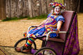 A girl dressed as a jester rides around the sherwood forest faire in mcdade texas on march Stock Photos