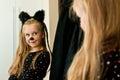 Girl dressed as kitten seeing herself Royalty Free Stock Photo