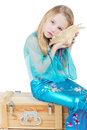 Girl dressed as mermaid sits and listen to noise Royalty Free Stock Images