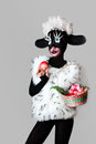 A girl dressed as a sheep the unusual costume and body art wit with basket an apple Royalty Free Stock Images