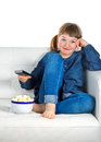 Girl dressed in blue denim watching TV Stock Photos