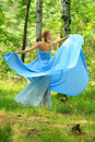 Girl dressed in blue dress Royalty Free Stock Photos