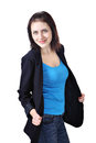 Girl dressed in dark blue jacket t shirt and jeans vertical portrait of one young smiling caucasian woman years old a office light Stock Photography