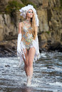 Girl dressed like a mermaid is walking on the  beach Royalty Free Stock Photo