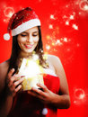 Girl dressed santa claus opens magic box Royalty Free Stock Photo