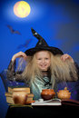 Girl dressed up as witch in night making magic Royalty Free Stock Images