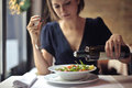 Girl dressing the salad Royalty Free Stock Photo