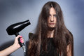 Girl dries long hair hairdryer Stock Photos