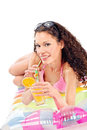 Girl drink juice on air mattress smiled curl isolated white Royalty Free Stock Photo
