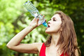Girl drink water in park after volleyball game Royalty Free Stock Photo