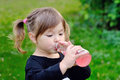 Girl drinking from a bottle of lemonade, Outdoors Royalty Free Stock Photo