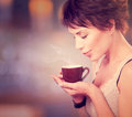 Girl drinking coffee beautiful tea or Stock Images