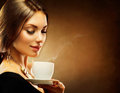 Girl drinking coffee beautiful tea or Royalty Free Stock Photography