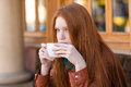 Girl drinking coffee in outdoor cafe Royalty Free Stock Photo