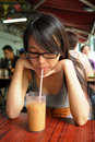 Girl drinking milk tea Stock Image
