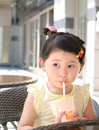 Girl drinking milky tea in the outside of the coffee shop Stock Photos