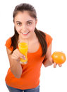 Girl drinking orange juice Stock Images