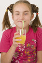 Girl drinking orange juice II Royalty Free Stock Photos