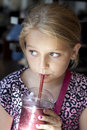 Girl drinking smoothie Stock Photography