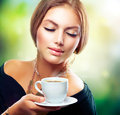 Girl Drinking Tea or Coffee Royalty Free Stock Photos