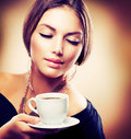 Girl Drinking Tea or Coffee Stock Photography