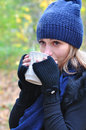 Girl drinking tea in the cold beautiful hot beverage Stock Photography