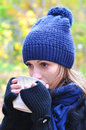 Girl drinking tea in the cold beautiful hot beverage Stock Images