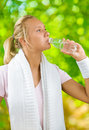 A girl drinking water fom small bottle Stock Image