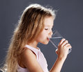Girl drinking water from glass child Stock Photo