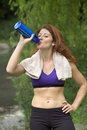 Girl drinking after workout Royalty Free Stock Photography