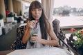 Girl drinks mojito Royalty Free Stock Photo