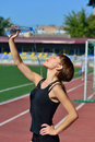 The girl drinks water at the stadium Royalty Free Stock Photo