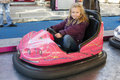 Girl driving a bumper car Royalty Free Stock Photo
