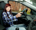 Girl driving her new car Stock Photos