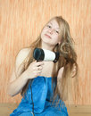 Girl dryes her long hair Royalty Free Stock Images