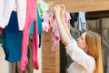 Girl drying clothes after laundry long haired on line Stock Image