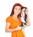 Girl drying her hair by dryer Stock Photos