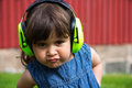 Girl with ear protection wearing designed for children Stock Photos