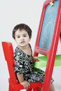 Girl on easel Stock Photos