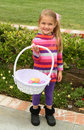 Girl with easter basket cute young eggs in Royalty Free Stock Photos