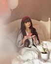 Girl eat breakfast in bed. Birthday. Royalty Free Stock Photo