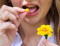 Girl eat flower petal Royalty Free Stock Photo