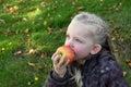 Girl eating apple Royalty Free Stock Photo