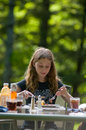 Girl eating bbq dinner Royalty Free Stock Photo