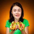 Girl eating big sandwiches Stock Image