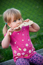 Girl eating bread Stock Photos
